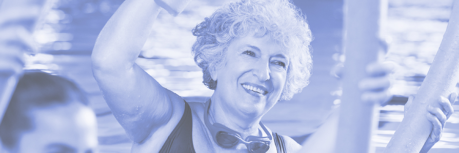 A woman in an aqua aerobics class