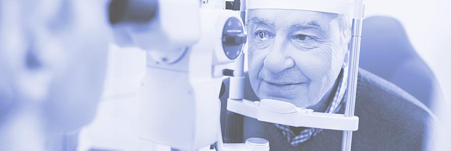 A man has an eye check up