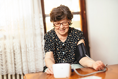 An older lady checking her blood pressure