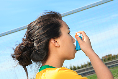 Young girl with an asthma inhaler