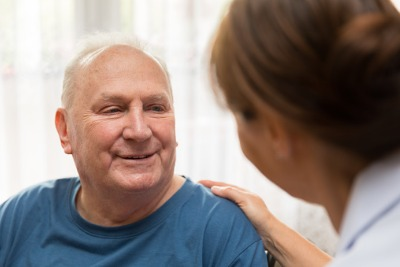 A man talking to his nurse
