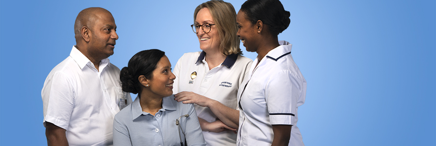 A group of NHS staff laughing together
